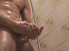 Pretty gentleman jerks off his stiff cock in the bathroom