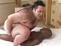 Lewd bear gay rides large black cock