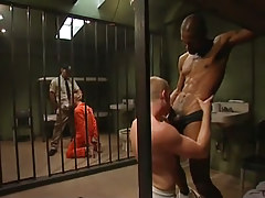 Two prisoners take in huge black cocks