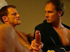 Cute gay plays with hard rod on sofa