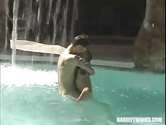 Pretty faggot boys kiss in pool