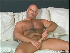 Lusty hairy man masturbates on sofa