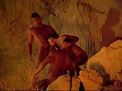 Three muscle gays suck each other in cave