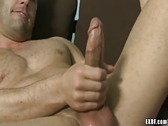 Hairy dilf masturbates on sofa