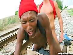 Ebony homo boy gets anal fuck behind on railyard