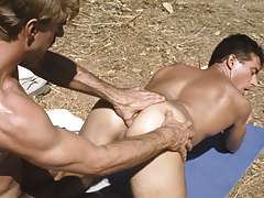 Alex down on his knees sucking the hiker's plump love muscle